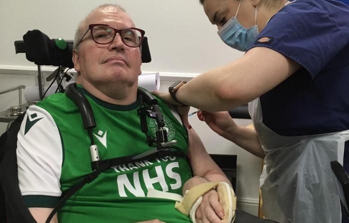 Graham receiving his Covid vaccine